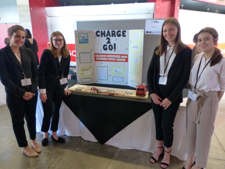 Students in front of Biotech project at fair