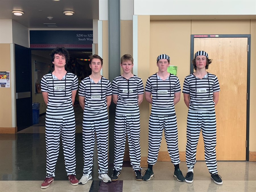 Students dressed in stripped jail suits for a project