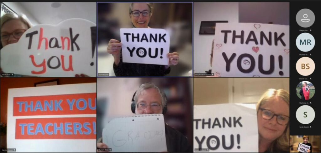 Thank you signs being held up at a Zoom Meeting