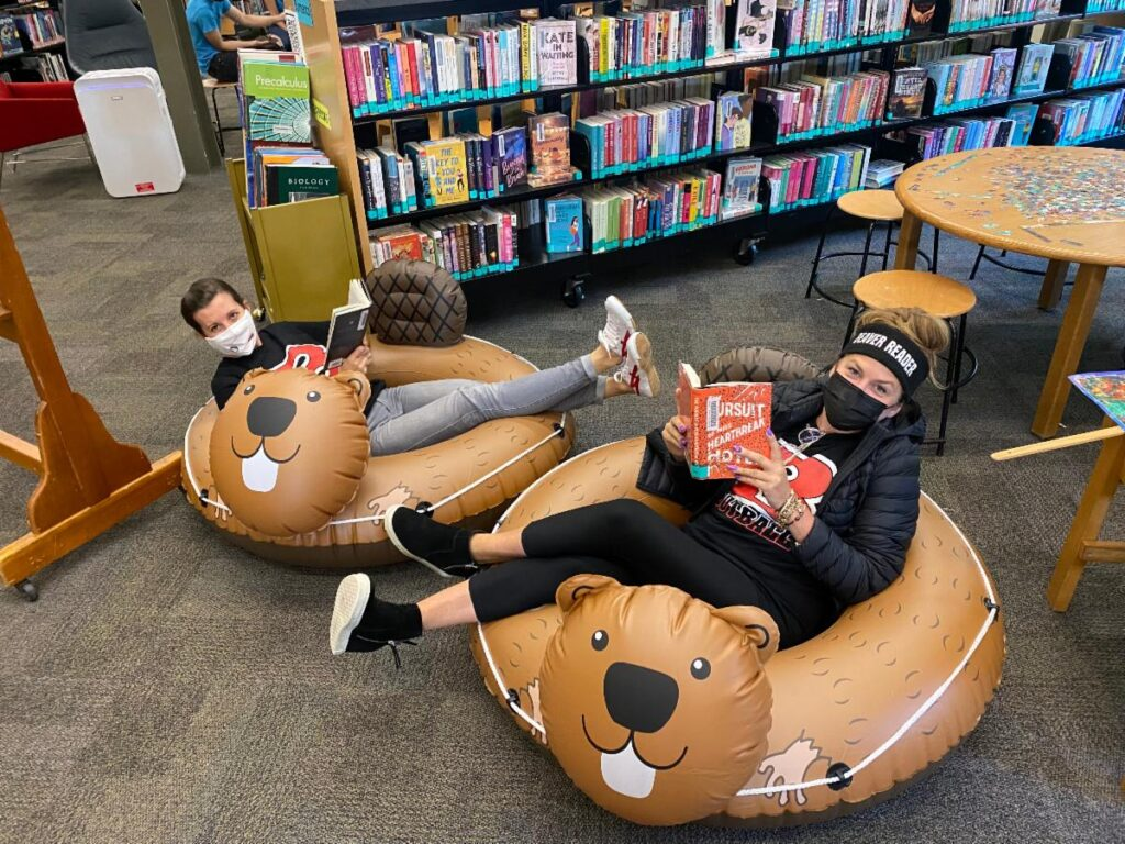 Beaver Rafts in the library with both librarians sitting and reading in them